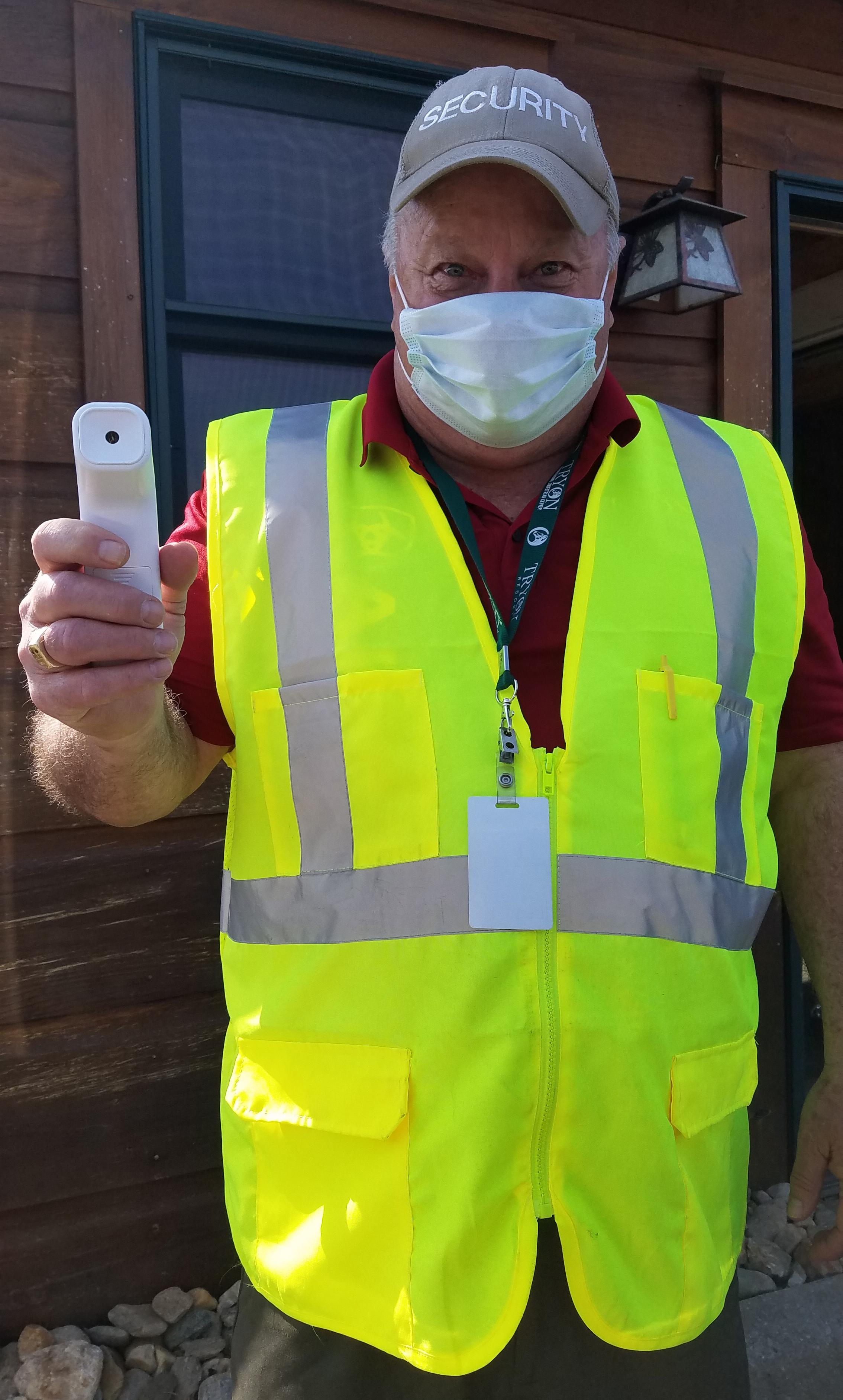 Tryon International Equestrian Center staff member ready to take temperatures upon entry.